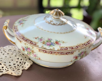 An elegant French white and gold lidded vegetable dish with an internal pierced dish c early 1900s. probably for asparagus