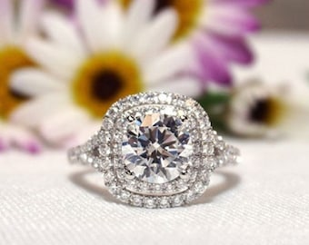 size 10 A wiresculpted ring of 14K gf wire  with  cubic zirconia stone set in a sculpted small flower with a wrapped shank