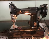221 Featherweight black sewing machine with, manual, case key and many accessories