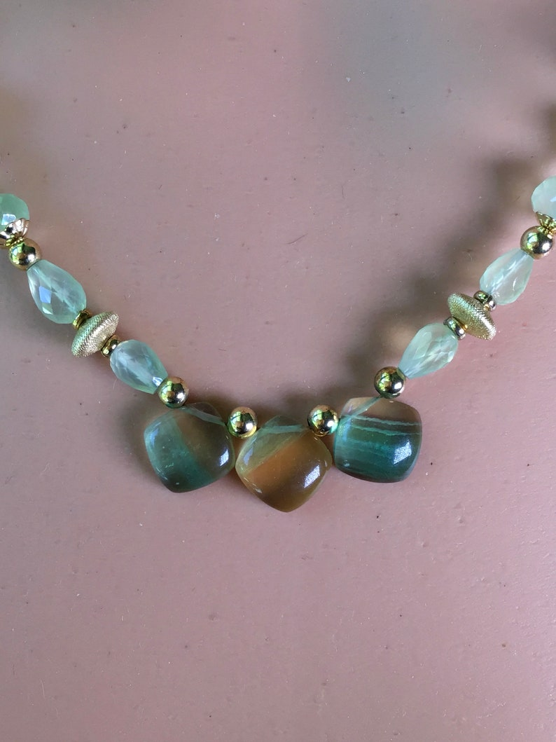 Lemon lime gemstones beaded necklace. Rainbow Gold and green fluorite pendant on a beaded strand of green prehinite