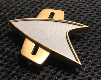 Star Trek Combadge from Deep Space Nine, Voyager and The Next Generation Movies.