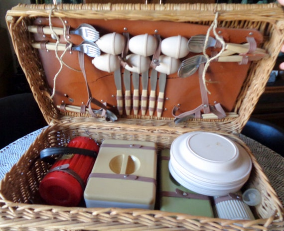 Collectible old picnic wicker basket With Dishware