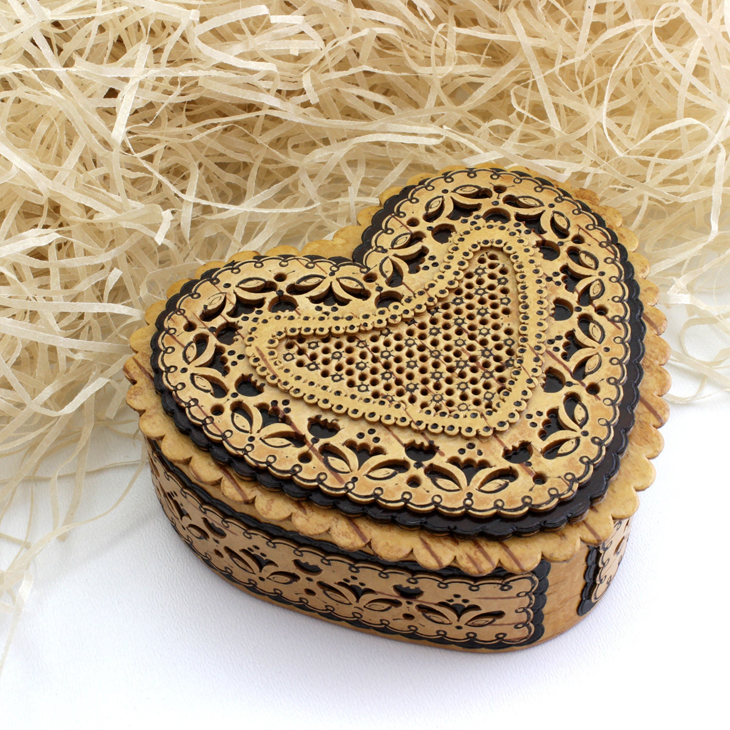 Heart-shaped box made of natural birch bark material. Inside is an image of an angel. Can be personalized