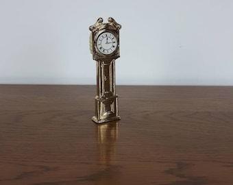 Brass vintage miniature grandfather clock.