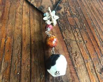 Gray Taqua Nut Open slice with black onyx round bead Rectangle bead and Black seed beads /&Sterling toggle and  Picture Jasper BrownGray