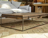 Large Coffee Table with an Industrial Metal Base made with reclaimed wood.