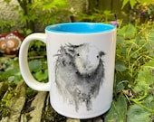 A Curious Herdwick Sheep Watercolour Mug with Blue Interior