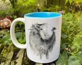 A Curious Herdwick Sheep Watercolour Mug with Blue Interior