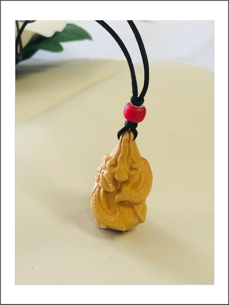 Boxwood Gourd Pendant Necklace features Cod Jump Over Dragon Gate