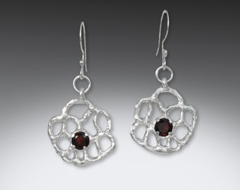 Cast Sterling Silver Setting With Sparkling Red Garnet
