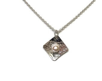 Delicately Textured Sterling Silver Setting With Pearl