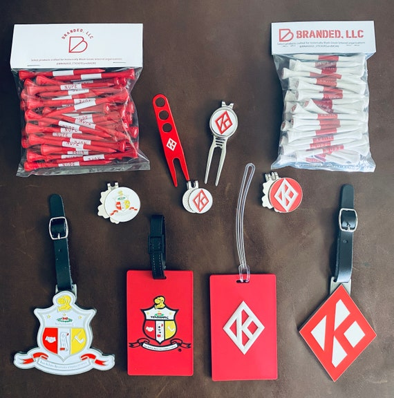 Nupe - The 'None Greater' package - includes items shown: 2 plastic bag tags, 2 metal bags, 3 ball markers, 2 divot tools, &  2 bags of tees