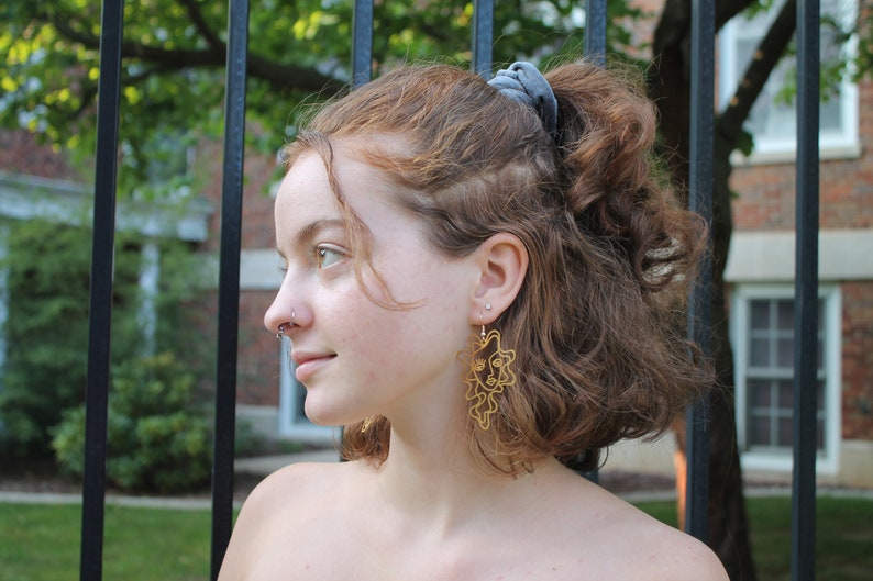 Gold Curly Hair Female Face Earrings