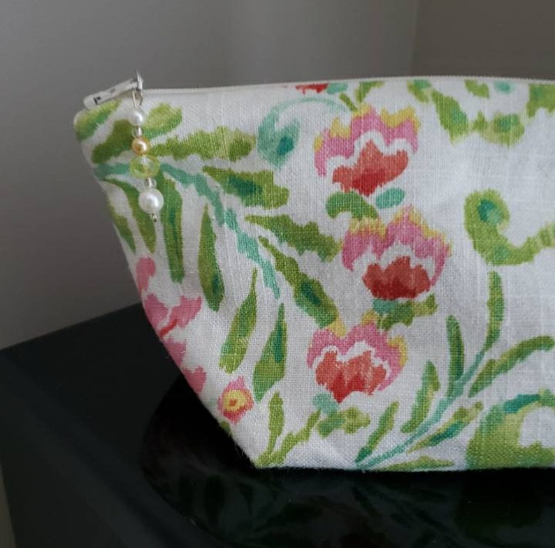 Lined zippered pouch.
