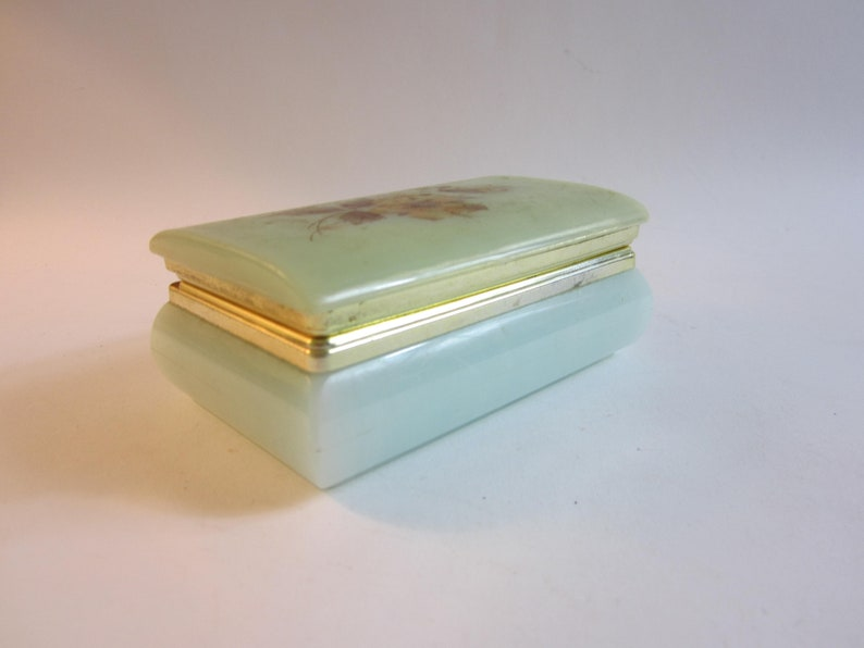 Stunning French vintage jewelry box made from plastic decorated with flower on the lid.