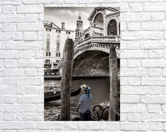 View of the Rialto Bridge over the Grand Canal in Venice Italy. Contemporary black and white artistic photography. Professional printing.