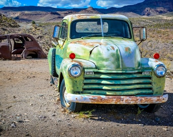 Abandoned old green pickup truck in the desert of Arizona, USA. Contemporary artistic color photo. Professional printing.