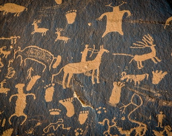 Petroglyphs on Newspaper rock in Canyonlands park, Utah, USA. Contemporary artistic color photo. Professional printing.
