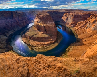 Horseshoe Bend is the meander of the Colorado River, Arizona, USA. Contemporary artistic color photo. Professional printing.