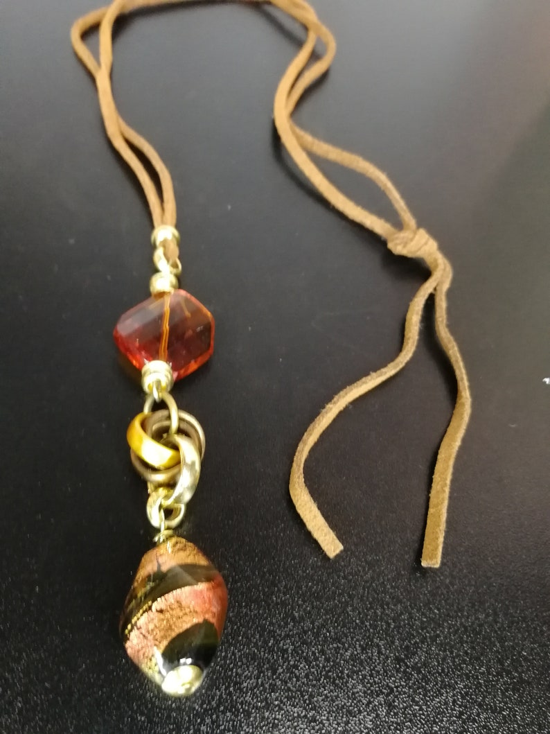 brown leather necklace with colored glass pendant