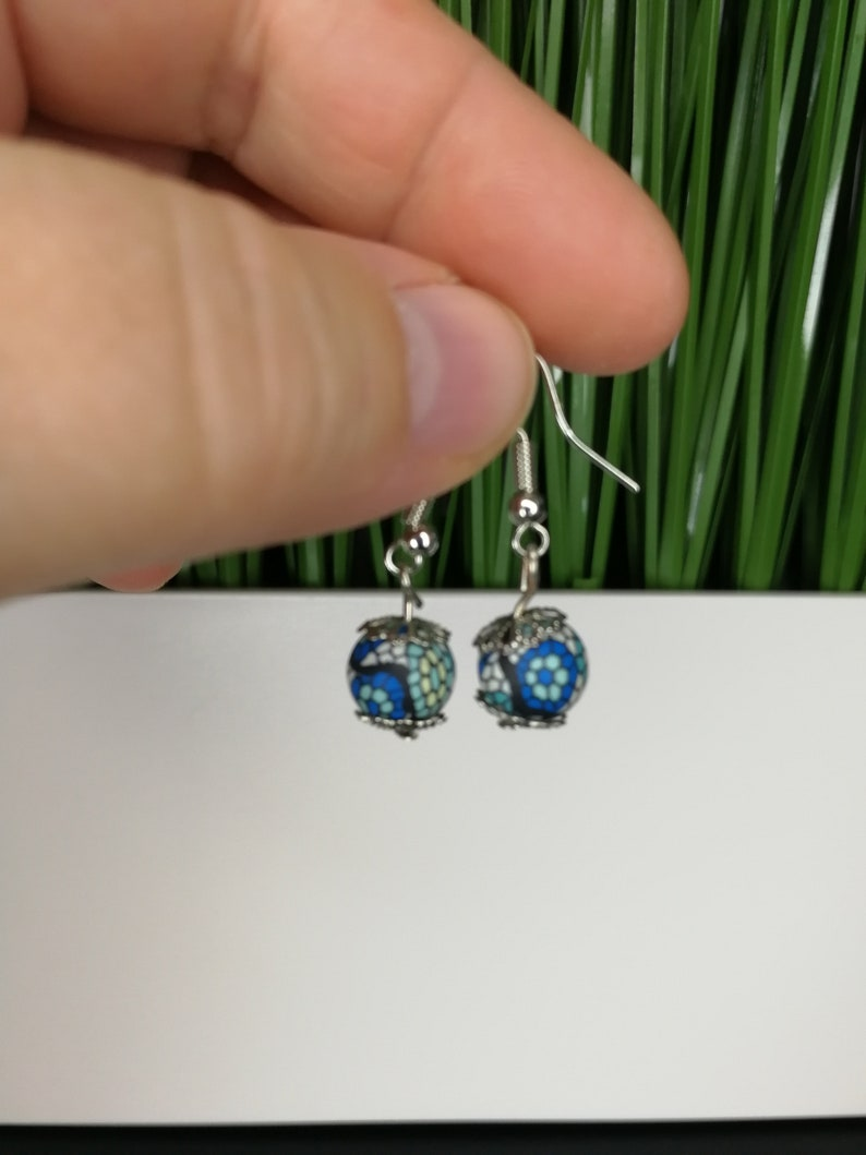 silver earrings with two blue colored pearls
