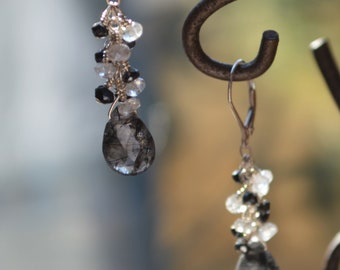 Rutilated quartz and silver clusters