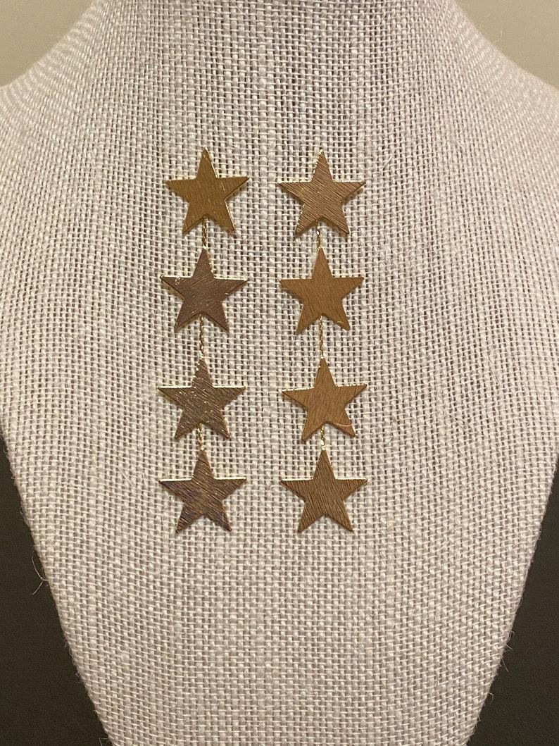 4 star gold earrings