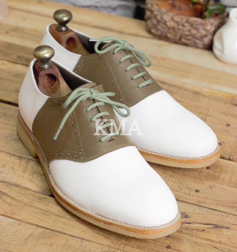 Saddle Shoes History- Women's and Men's Handmade Cap toe Mens oxford shoes Genuine leather shoes for men. $89.99 AT vintagedancer.com