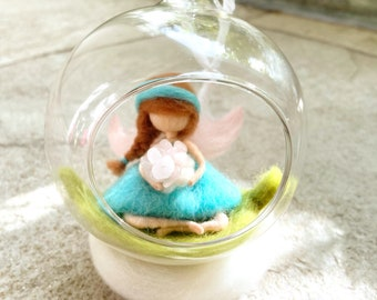 Blue Fairy holding crystals, sitting a cute leaf inside a bubble glass.