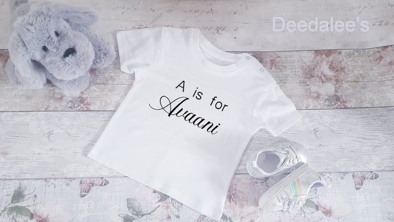 Personalised Baby whiteblack name and initial T-ShirtBodysuit with glitter