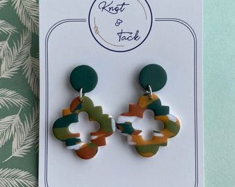 Irish green marbled cross quatrefoil style polymer clay earrings in forest green, burnt orange and golden yellow