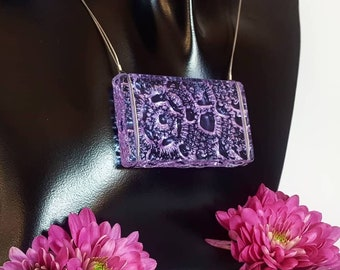 Purple glass necklace with crochet pattern