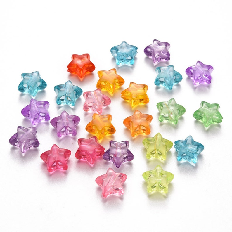 100 x coloured transparent plastic acrylic stars green pink red blue orange purple drilled yellow approximately 10.5mm x 11mm x 6mm