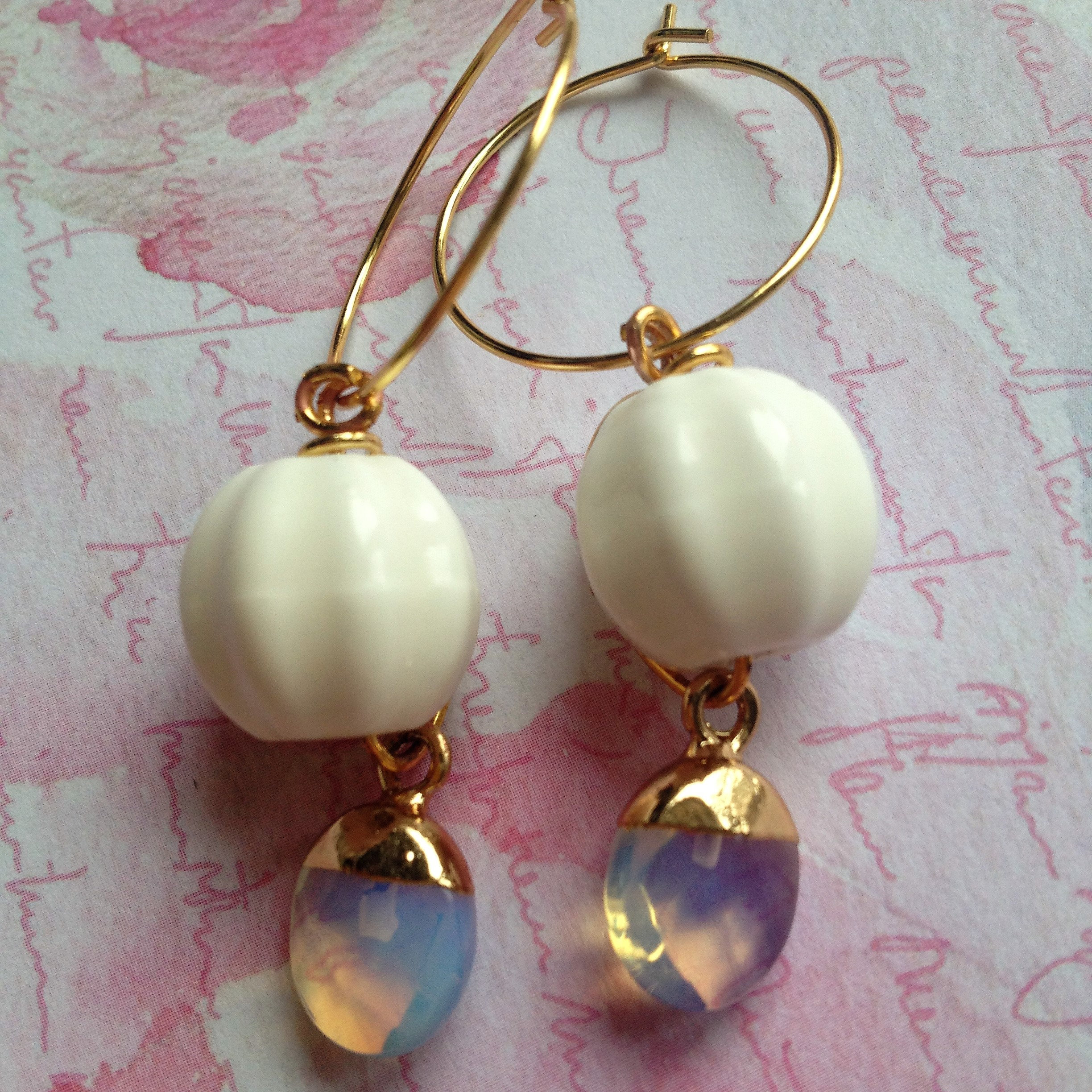 Porcelain earrings with opalescent accents