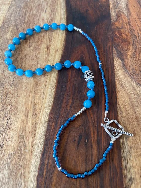 Beautiful boho style gemstone beaded pendant .