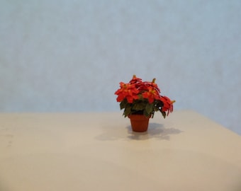 """Poinsettia, red  1/4"""" dollhouse scale   These flowers are not real!"""