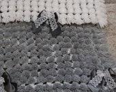 Grey and white pom pom blanket