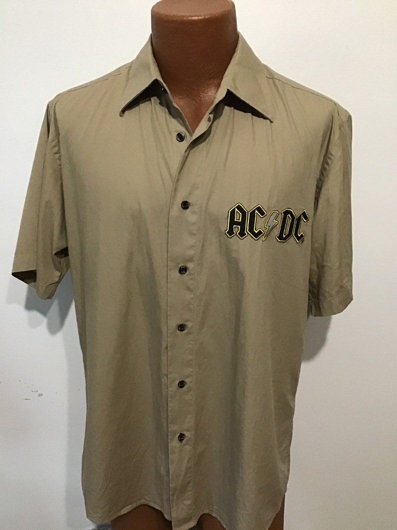 Gold outlining letters AC DC Rockware cotton beige shirt Licensed Made in USA