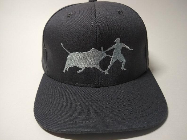 Bull Fighter Silhouette on Charcoal cap with full back flat visor