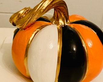 Whimsical black, orange and  white pumpkin