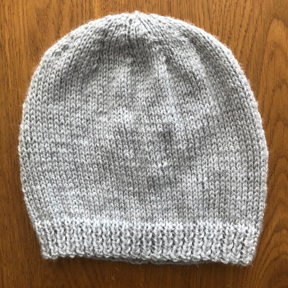 Hand Knit child\u2019s pink and white star hat