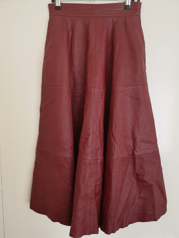 Vintage womens A-line red leather skirt size 38
