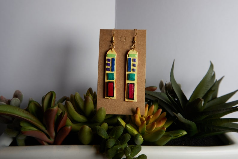 hand sculpted and painted Neon Jaw Dropper earrings!