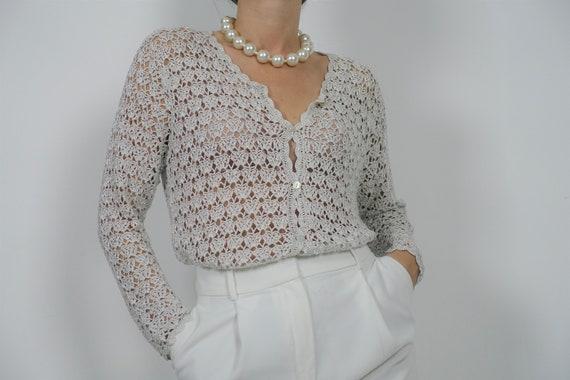 Crochet cardigan with silver yarn