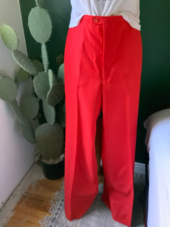 Red vintage high waist pants with a wide leg