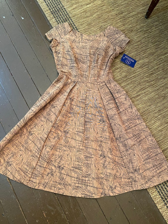1950s A-line squiggle dress.