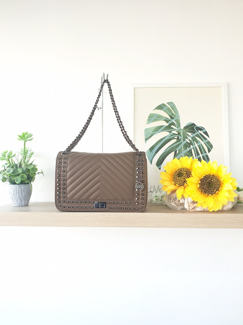 shoulder bag for women in real leather tassel sauvage quilted with studs handmade in Italy Roberta Rossi made in Italy
