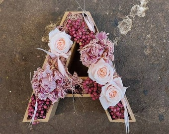 Letters of choice stuck with dried flowers