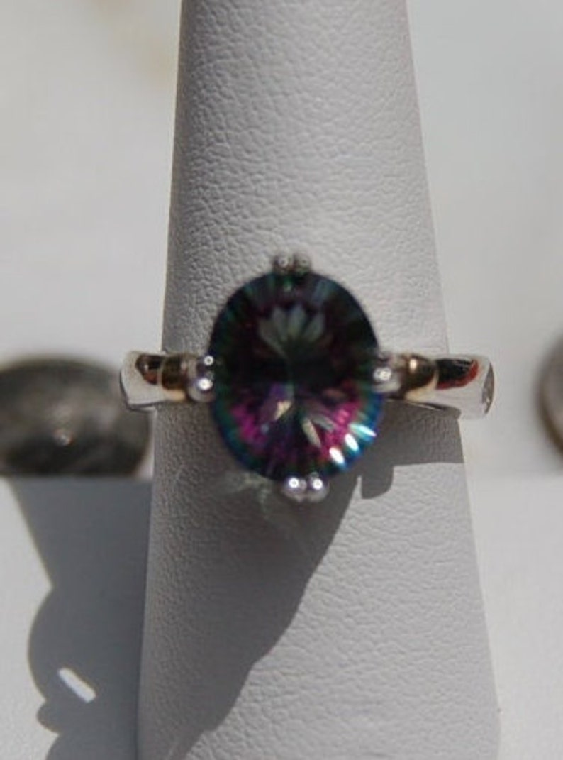 Medium Rainbow Topaz Ring set in a Sterling Silver Mounting