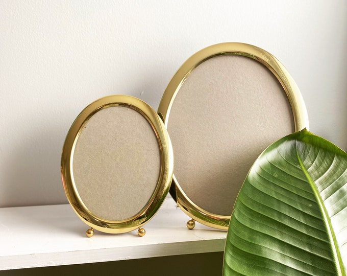 Featured listing image: Brass Oval Mid Century Set of Two Picture Frames